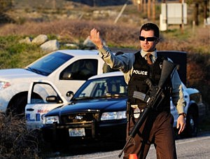 A Redlands police officer secures at a blockade during a manhunt for the former Los Angeles Police Department officer Christopher Dorner
