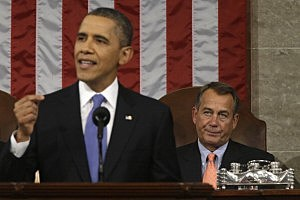 :  House Speaker John Boehner (R-OH) (R) listens as U.S. President Barack Obama gives his State of the Union address