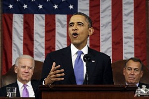 President Barack Obama, flanked by Vice President Joe Biden and House Speaker John Boehner (R-OH), delivers his State of the Union speech