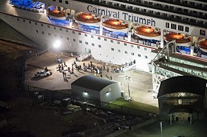 The media await the final unloading from the crippled cruise liner Carnival Triumph February