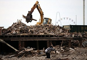 Debris from the damaged Casino Pier is removed