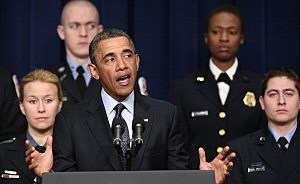 Surrounded by first responders who may be impacted by looming budget cuts, President Barack Obama speaks during an event at the Eisenhower Executive Office Building