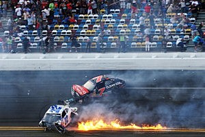 Kyle Larson, driver of the #32 Clorox Chevrolet, and Regan Smith, driver of the #7 Clean Coal Chevrolet, are involved in an incident at the finish of the NASCAR Nationwide Series DRIVE4COPD 300
