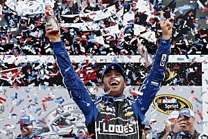 Jimmie Johnson, driver of the #48 Lowe's Chevrolet, celebrates in victory lane after winning the NASCAR Sprint Cup Series Daytona 500