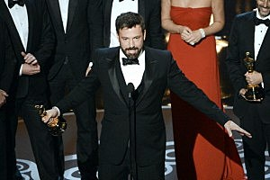 "Actor/producer/director Ben Affleck accepts the Best Picture award for ""Argo"" onstage along with members of the cast and crew"