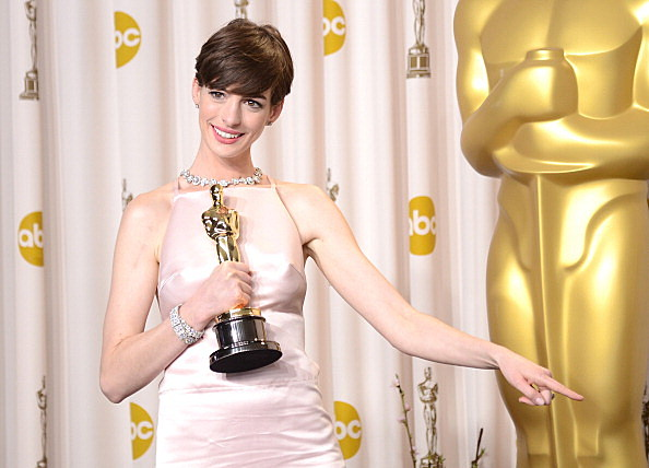 "Anne Hathaway, winner of the Best Supporting Actress award for ""Les Miserables,"" poses in the press room"