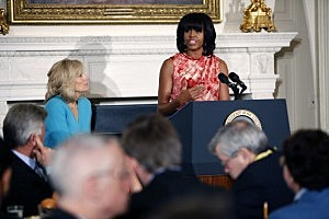 Dr. Jill Biden (L) listens as first lady Michelle Obama speaks to the National Governors Association