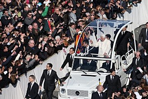 Pope Benedict XVI travels in the popemobile as he arrives in St Peter's Square ahead of final general audience