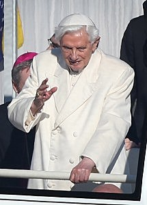 Pope Benedict XVI waves to the faithful as he arrives in St Peter's Square