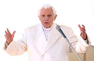 Pope Benedict XVI delivers his blessing during his final general audience in St Peter's Square
