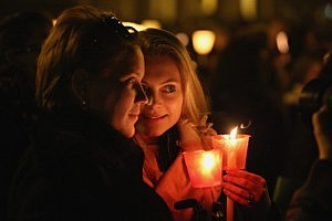 Pilgrims and clergy hold a candle-lit vigil in Saint Peter's Square, facing Pope Benedict XVI's private apartment, after his final weekly public audience