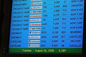 Arrivals are displayed on a monitor as numerous flights were delayed or canceled at Hartsfield-Jackson Atlanta International Airport