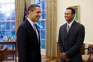 President Barack Obama (L) talks with  Tiger Woods at the White House in 2009