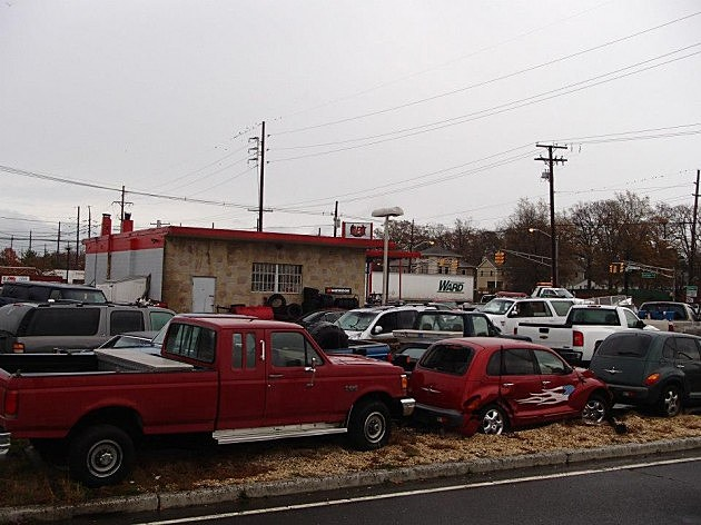 Cars towed from Seaside Heights surround APK Towing's building on Route 37 in Toms River