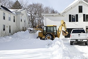 Clearing snow in Saco, Maine