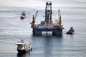 Ships work near the site of the BP Deepwater Horizon oil spill in the Gulf Of Mexico in 2010