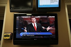 Sen. Rand Paul (R-KY) is seen on a TV monitor as he participates in a filibuster on the Senate floor