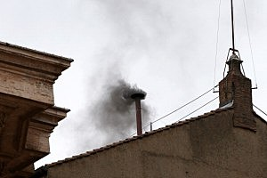 Black smoke billows out from a chimney on the roof of the Sistine Chapel indicating that the College of Cardinals have failed to elect a new Pope