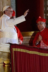 Newly elected Pope Francis appears on the central balcony of St Peter's Basilica