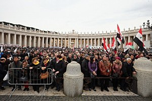 People gather in St Peter's Square ahead of the arrival of Pope Francis