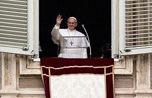 Pope Francis gives his first Angelus Blessing to the faithful from the window of his private residence