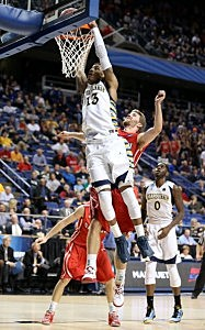 : Vander Blue #13 of the Marquette Golden Eagles shoots against Nik Cochran #12 of the Davidson Wildcats