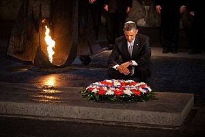 President Barack Obama pays his respects in the Hall of Remembrance