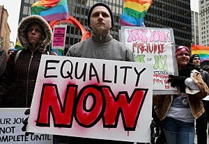 Stephen Barker (C) participates in a rally in support of gay marriage in Chicago