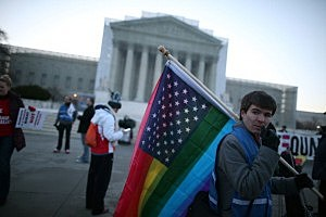 Justin Kenny of Akron Ohio holds a modified Stars and Stripes flag in front of the U.S. Supreme Court,
