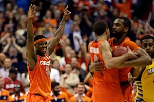 C.J. Fair #5 of the Syracuse Orange celebrates after defeating the Marquette Golden Eagles to win the East Regional Round Final of the 2013 NCAA Men's Basketball Tournament