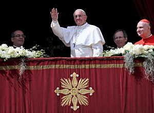 Pope Francis delivers his first 'Urbi et Orbi' blessing from the balcony of St. Peter's Basilica during Easter Mass