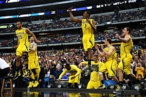 The Michigan Wolverines bench celebrates their 79 to 59 win over the Florida Gators