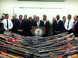 Officials display some of the guns turned in as part of the Monmouth County gun buyback program