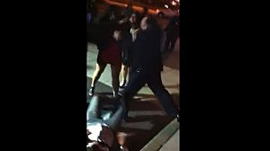 Screen shot of video showing an Elizabeth police officer appearing to punch a woman