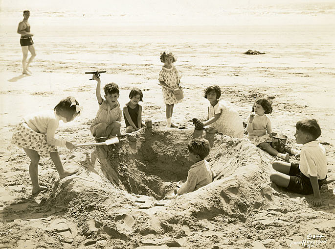 These children play on the beach in Atlantic City, NJ circa 1940s to 1950s.