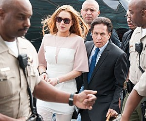 Lindsay Lohan (L) and her lawyer Mark Heller arrive to Lohan's trial