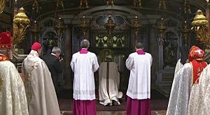 Pope Francis prayed at the tomb of St. Peter, beneath St. Peter's main alter, before his installation mass on Tuesday.