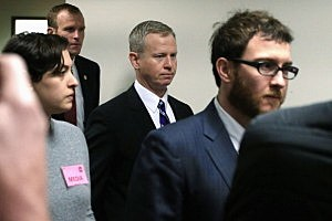 George Brauchler (C), District Attorney in Colorado's 18th Judical District, arrives at the courtroom for a hearing on Aurora theater shooting suspect James Holmes