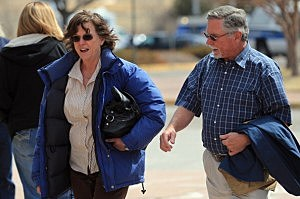 Arlene (L) and Robert Holmes, the parents of Aurora theater shooting suspect James Holmes, arrive at the court house after a midday recess during a hearing in the Arapahoe County Justice Center