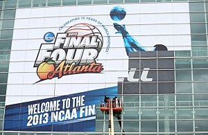 A stadium workers put up official NCAA signage on the exterior of the Georgia Dome in Atlanta