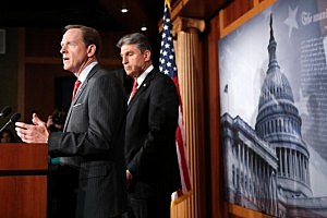 Sen. Pat Toomey (R-PA) (L) and Sen. Joe Manchin (D-WV) speak to the press about background checks for gun purchases