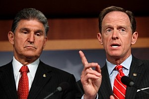 Sen. Pat Toomey (R-PA) (R) and Sen. Joe Manchin (D-WV) speak to the press about background checks for gun purchases, in the U.S. Capitol building