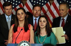 Erica Lafferty (2nd-L) and Jillian Soto (2nd-R), who both lost family members in the Newtown shooting, urge Congress to pass tougher gun laws during a news conference