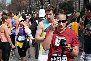 Runners react near Kenmore Square after two bombs exploded during the 117th Boston Marathon