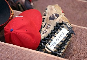 Ben Revere of the Philadelphia Phillies has a message on his gloves during the game agianst the Cincinnati Reds
