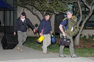 Police and federal officials exit an apartment complex at 364 Ocean Avenue in Revere, Mass. with a possible connection to the earlier expolsions during the Boston Marathon