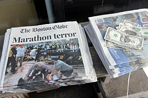 Newspapers are on sale at a stand on Newbury Street