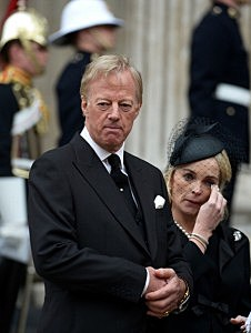 Mark Thatcher and his wife Sarah Thatcher leave St Paul's Cathedral after the Ceremonial funeral of former British Prime Minister Baroness Thatcher