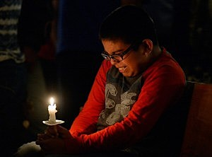 Eric Garcia,12,  cries during a candelight vigil and prayer honoring the victims of West Fertilizer Company explosion at St. Mary's Assumption Catholic Church