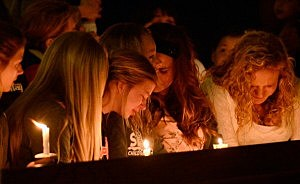Residents attend a candelight vigil and prayer honoring the victims of West Fertilizer Company explosion